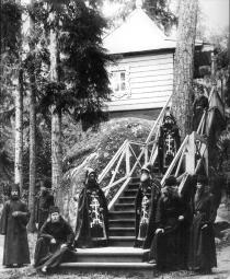 Skhimniks and monks of the Konevsky Monastery of the Nativity near the forest chapel in the Kon-stone. Photograph of the 1900s.