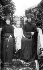 Nuns of the Staraya Ladoga Convent of the Dormition and pupil at the territory of the Convent. Photograph of the 1900s.