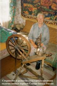 Ingermanland Finnish woman   from Vybye Village  with the traditional spinning wheel